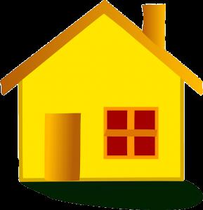 Litet gult hus som kan värmas upp med hjälp av solpaneler och solenergi